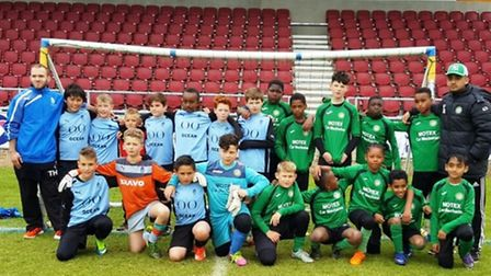 Pro Touch Under-11s (blue) with their MK Galacticos opponents at Northampton Town