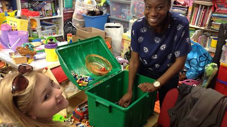 Volunteers Jess Doyle and Kim Nyamhondera help with the toy sorting