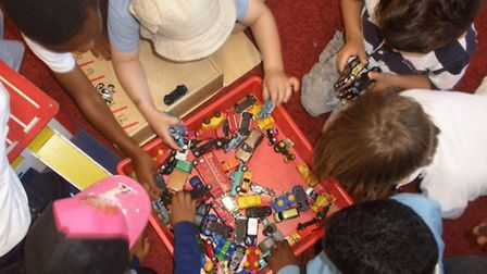 Children play with some of the toys donated