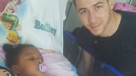 Pop star Nic Jonas with Bailey following her operation today (Pic: Facebook)