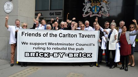 Friends of the Carlton Tavern demonstrate outside Westminster City Hall before a public inquiry ins
