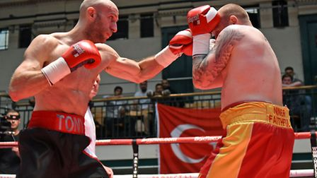 Tony Milch (black/white shorts) defeated Lewis van Poetsch on points at York Hall. Pic: Philip Shark