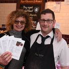 Kay Scorah with some of her Essex Road food recipes and butcher Wayne Roberts (Picture: Ken Mears)