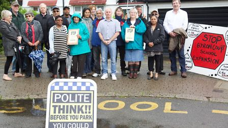 Protestors Cllr Keith Perrin, far right, with residents.against antisocial behaviour caused by parki