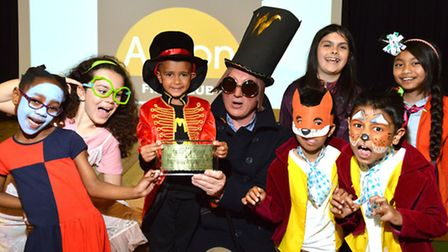 Pupils with teacher Gary Bradfield celebrate Roald Dahl's 100th anniversary with an authentic Willy