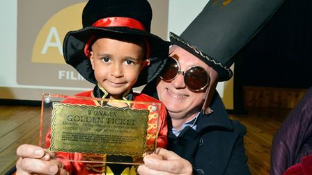 Adam, four, with teacher Gary Bradfield and the Willy Wonka Golden Ticket at Anson Primary School's