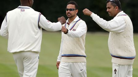 Hornsey captain Paul Weekes (centre) is congratulated by his team-mates Steve Atkinson (left) and Ch
