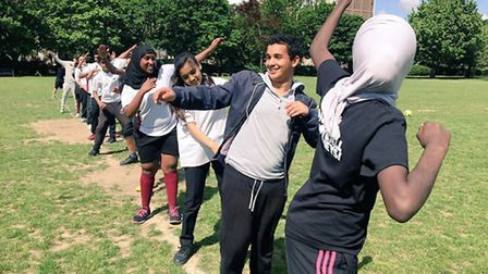Schoolkids from Bethnal Green and Wembley mix together for football at Weavers Field park