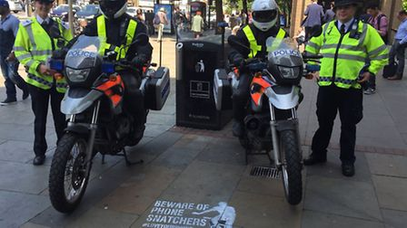 Police at the launch of their moped crime crackdown outside Angel Tube on Monday (Picture: Met Polic