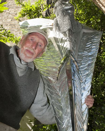 Stephen Flanagan with one of the sculptures in his Richmond Crescent garden. Picture: Nigel Sutton