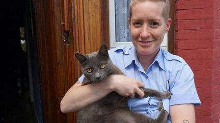 Alisa Ford, animal welfare officer at Mayhew Animal Home with Smokey the cat who was rescued by Will