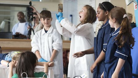 Grafton Primary School pupils in a theatrical performance telling the story of Whittington Hospital.