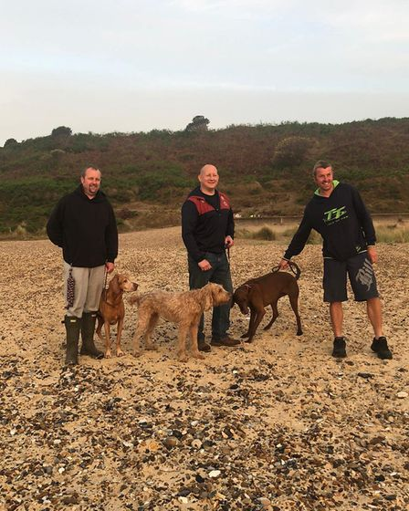 The husbands of the three families with their dogs, who also ventured along at 3.45am to catch the m