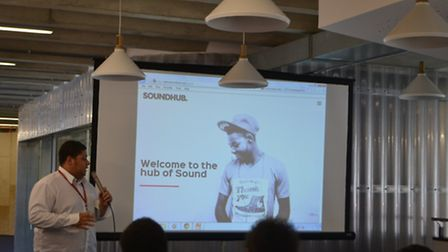 Student Covell Louis-Halladay presents the website to an audience