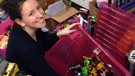 Lilly Lambert, one of the volunteers, sorts through some donations