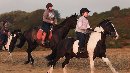 Elsie (right) and Charlotte, riding their horses Archie and Hugo. Photo: Jane Allard