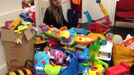 Volunteer Jess Doyle sorting out the surplus of donations