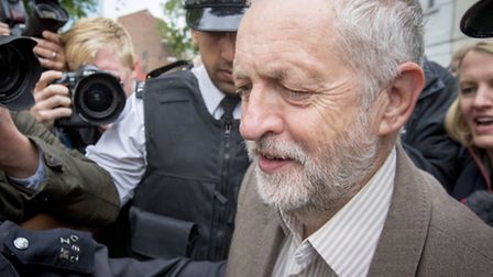 Jeremy Corbyn leaves his house in Holloway this morning after he promoted key allies, including Isli