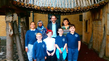 Headteacher Damien Parrott and Solihull coordinator Yasmin Stephenson with some of the children