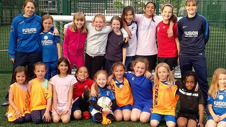 Fusion FC coaches Sarah Cleary (left) and Carrie-Anne Layton (right) with girls at the weekly coachi
