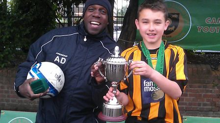 Isledon Wolves player Ethan Irvine (right) and coach Adrian Daley celebrate cup success in 2013
