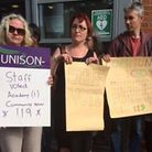 Teachers and volunteers protesting outside The Bridge School, which is set to become an academy desp