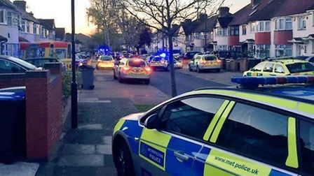Police and paramedics at the scene of a shooting in Grove Way, Wembley (Pic: Twitter@LAS_JRU)