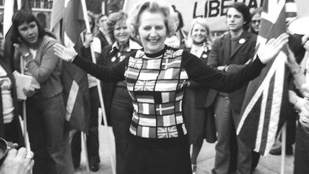Margaret Thatcher, sporting a sweater bearing the flags of European nations, in Parliament Square du