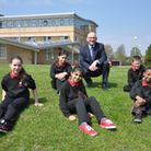 Mike Hulme with QPCS pupils outside the school