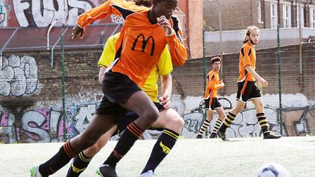 Isledon Wolves' Nicky Marshall on the attack in their friendly against Oxford United's academy side