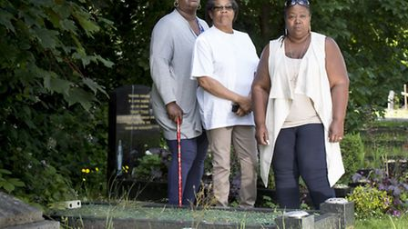Antonette Brown, Audrey Morris and Angela Barnes at their parents' grave in Islington and Camden Cem