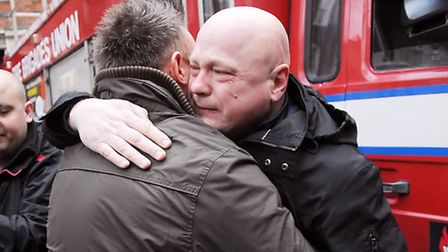 Tearful firefighter Alex Badcock is consoled by a colleague after Clerkenwell Fire Station's last ev