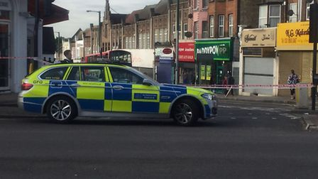 Police at the scene in Ealing Road, Wembley