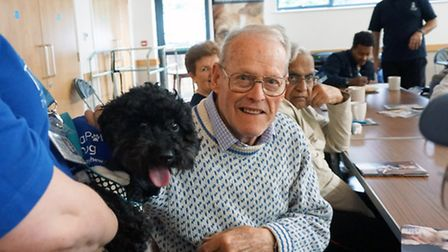 Jack with Shadow at the Alzheimer Society cafe in Kingbury as part of the Mayhew Animal Home Therapa