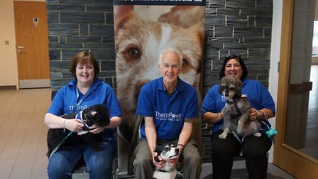 Carole, Bill and Debbie with their dogs Shadow, Tess and Noodle, all volunteers for the Mayhew Anima