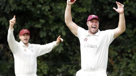 Highgate captain Jake Sharland celebrates the fall of an Acton wicket. Pic: Max Flego