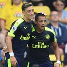 Mesut Ozil (left) and Alexis Sanchez celebrate at Vicarage Road as Watford's Jose Holebas looks on