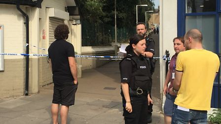 Police speak to bystanders outside Caledonian Road and Barnsbury station (Picture: Sam Gelder)