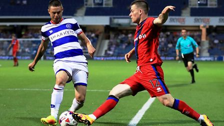 QPR's summer signing Ariel Borysiuk (left) in action against Rochdale. Pic: PA