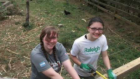 Camilla, right, helping to build a school in Nicaragua