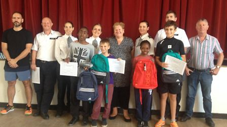 Pupils are awarded for their commitment and behaviour during the summer school project at Newman Cat
