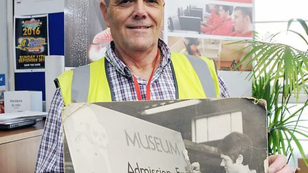 Alan Arthy at the Mears Group HQ in Caledonian Road with an old photo of himself as an apprentice