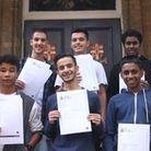 Central Foundation Boys' School students celebrate their GCSE results. Back: Mohamed Saci, Sirdas Ab