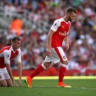Arsenal's Rob Holding (left) and Calum Chambers look downcast as their side go 4-1 down against Live