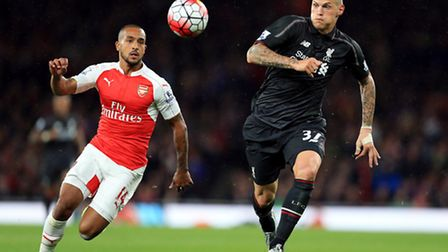 Liverpool's Martin Skrtel (right) and Arsenal's Theo Walcott during last season's 0-0 draw between t