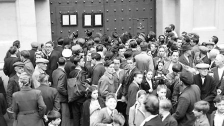 People gather outside Pentonville Prison in 1947 to see notice of execution of Christopher Geraghty,