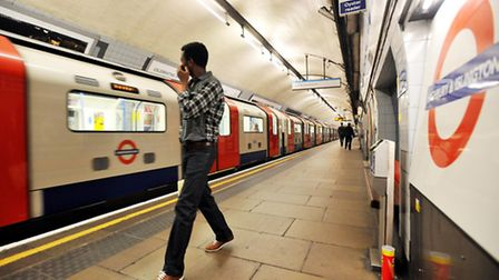Commuters and a tube of Pringles on the Victoria line platform at Highbury & Islington Station. Pict