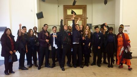 The students celebrating their graduation at a ceremony at University College London