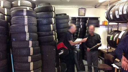 Brent and Harrow Trading Standards officers inspecting a used tyre shop (Pic: Brent Council)