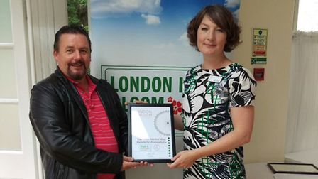 Bernard Fitzpatrick being presented his award by Brid O'Dwyer, from the Royal Horticultural Society
